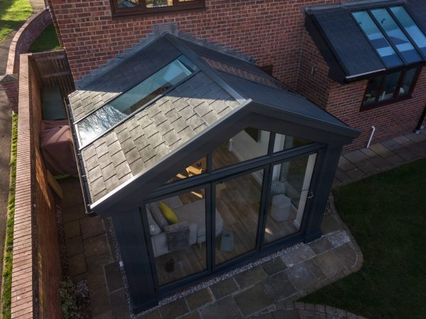 An Outside view of a conservatory with a solid roof from Safeguard